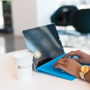 person using blue Microsoft Surface